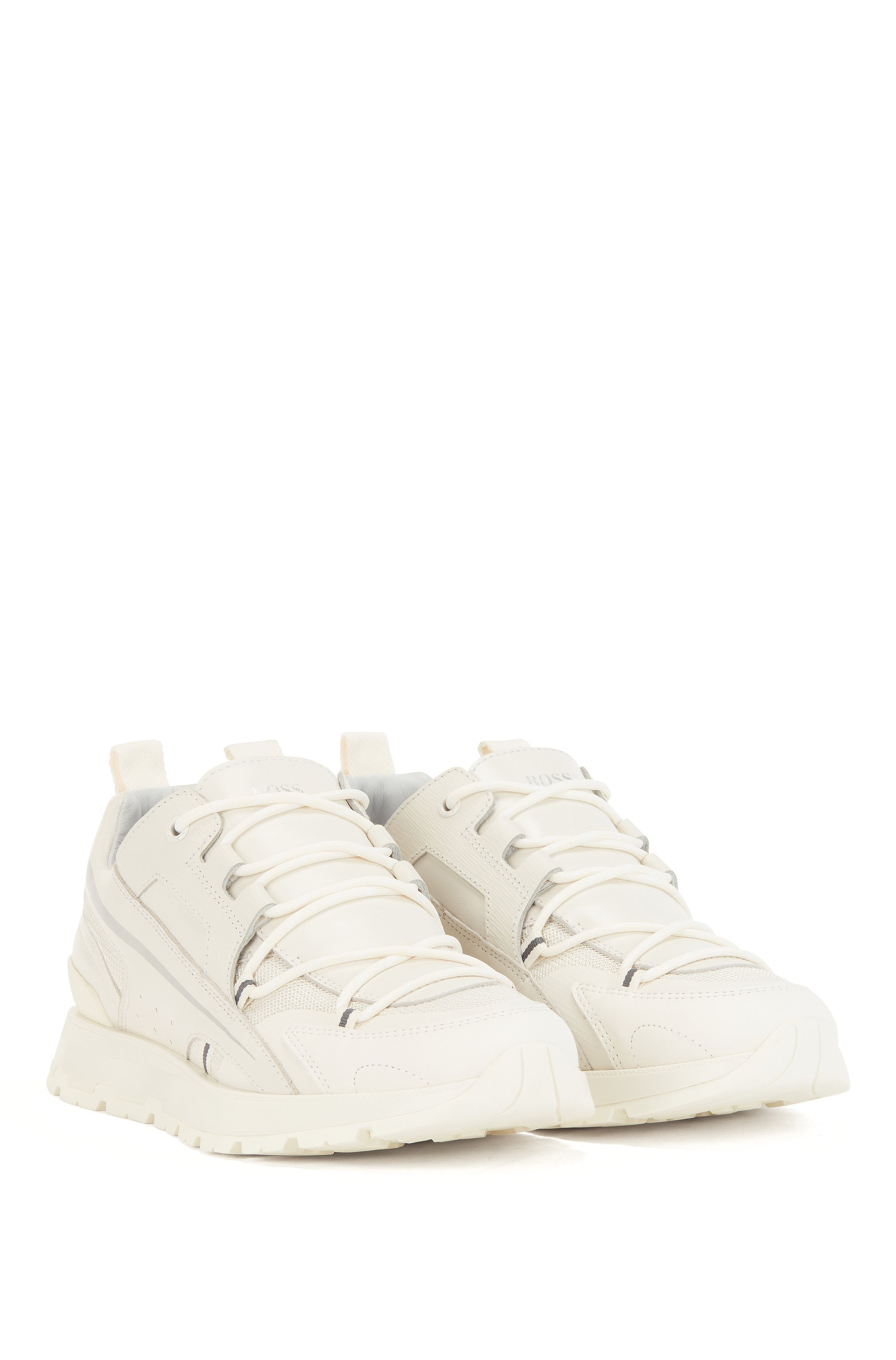 Low-top trainers in mixed materials with metallic stripe