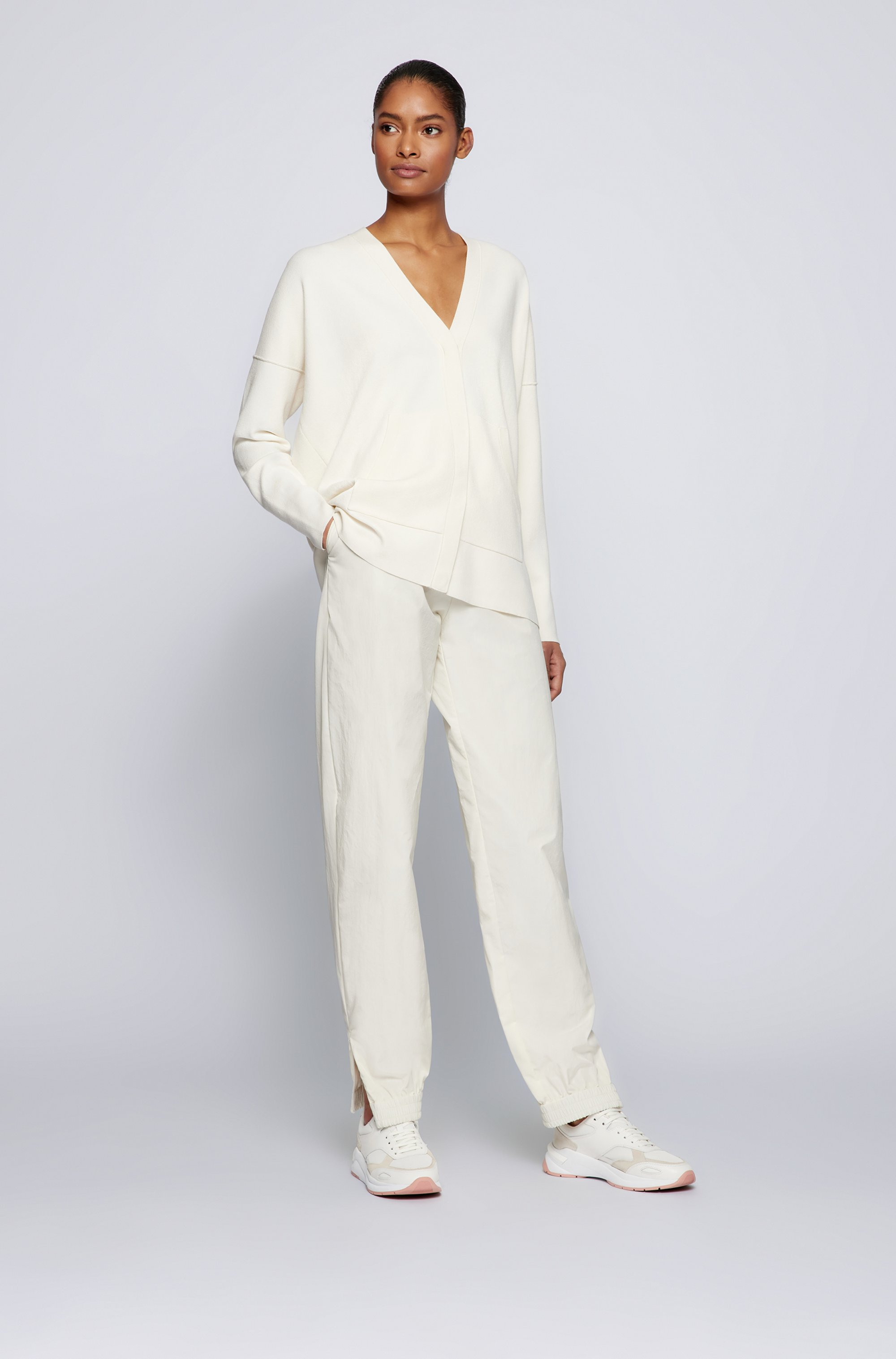 Relaxed-fit trousers with cuffed zipped hems