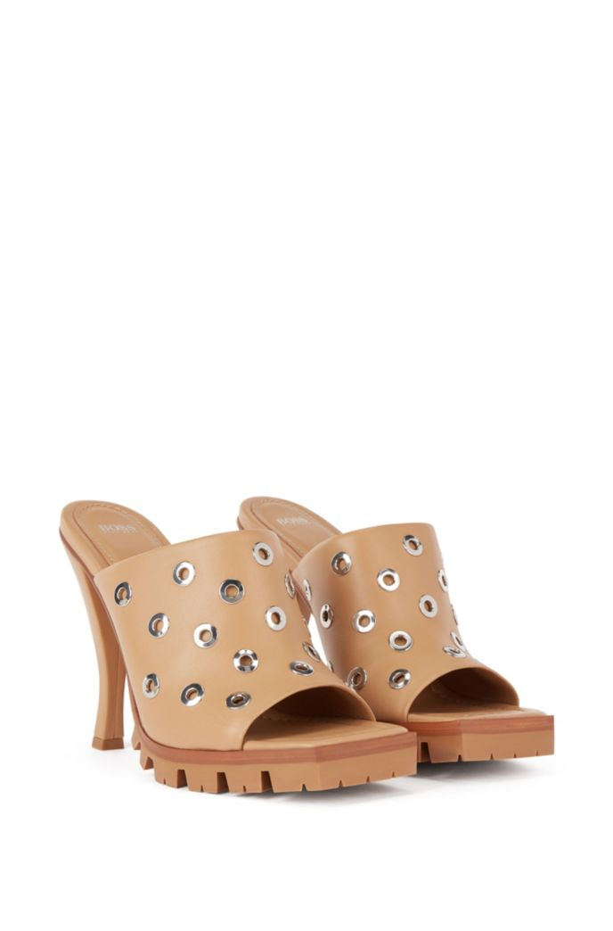 High-heeled mules in nappa leather with eyelet trim