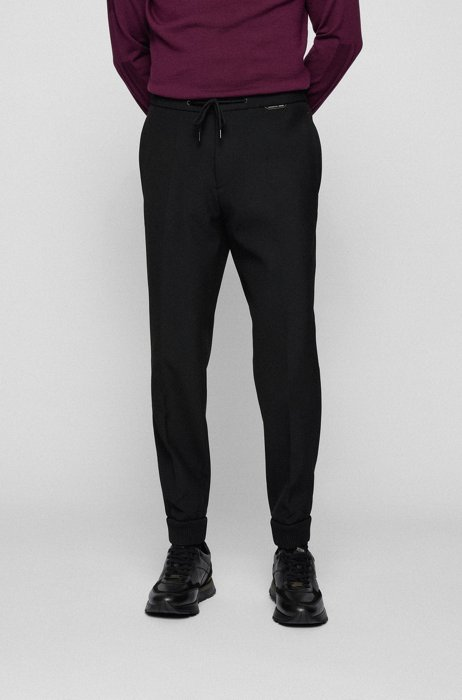 Slim-fit trousers in stretch fabric with knitted cuffs, Black