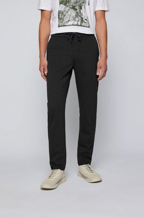Pantalones tapered fit en punto jaspeado con elástico, Negro