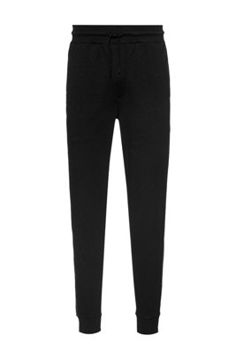 Regular-fit tracksuit bottoms with cropped-logo side stripes, Black