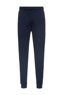 Regular-fit tracksuit bottoms with cropped-logo side stripes, Bleu foncé