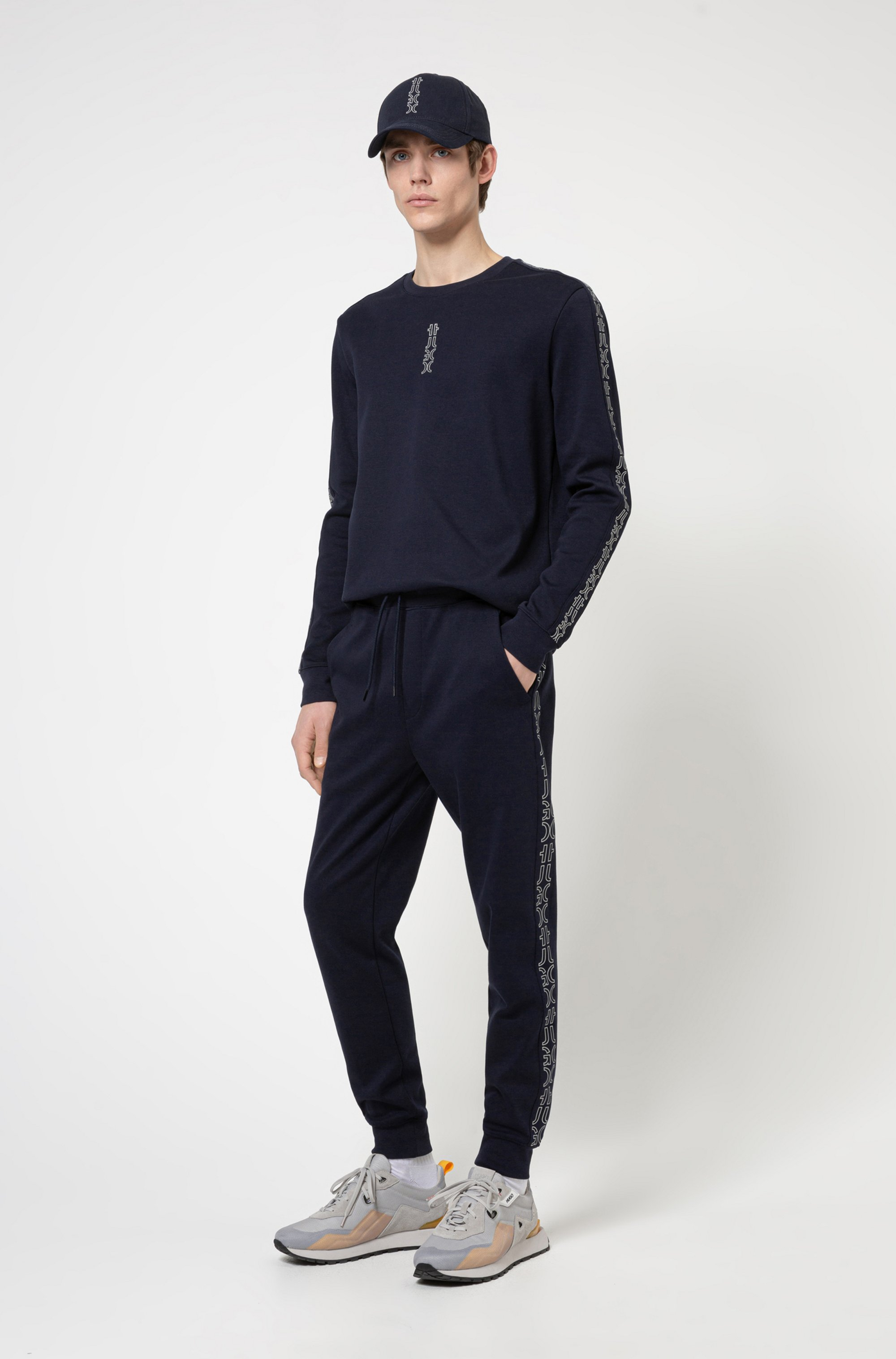 Regular-fit tracksuit bottoms with cropped-logo side stripes