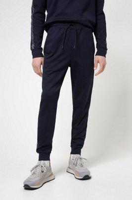 Regular-fit tracksuit bottoms with cropped-logo side stripes, Bleu foncé