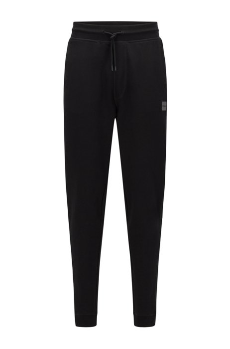 Cotton-terry tracksuit bottoms with logo patch, Black