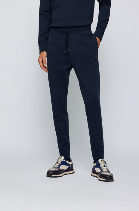 Cotton-terry tracksuit bottoms with logo patch, Dark Blue