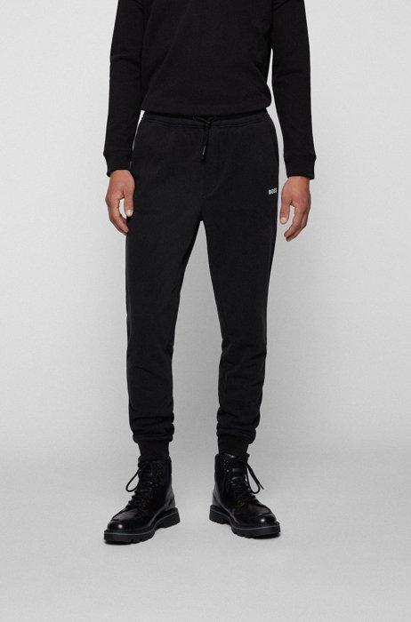 Cotton-blend tracksuit bottoms with logo detail, Black