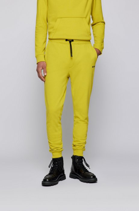 Cotton-blend tracksuit bottoms with logo detail, Yellow