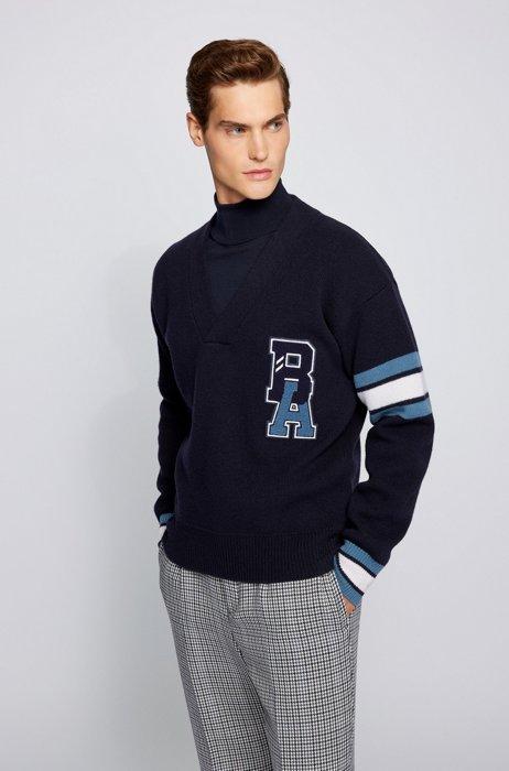 Pullover aus Schurwolle mit V-Ausschnitt und exklusivem Logo, Dunkelblau
