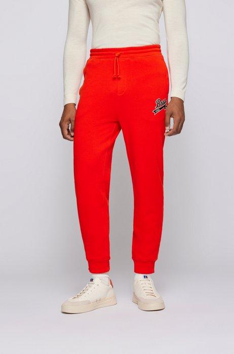 Cotton-blend tracksuit bottoms with exclusive logo, Orange