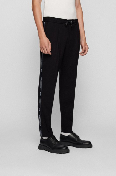 Relaxed-fit trousers with logo-tape trim, Black