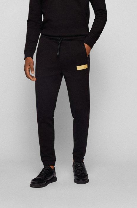 Cotton-blend tracksuit bottoms with contrast logo, Black