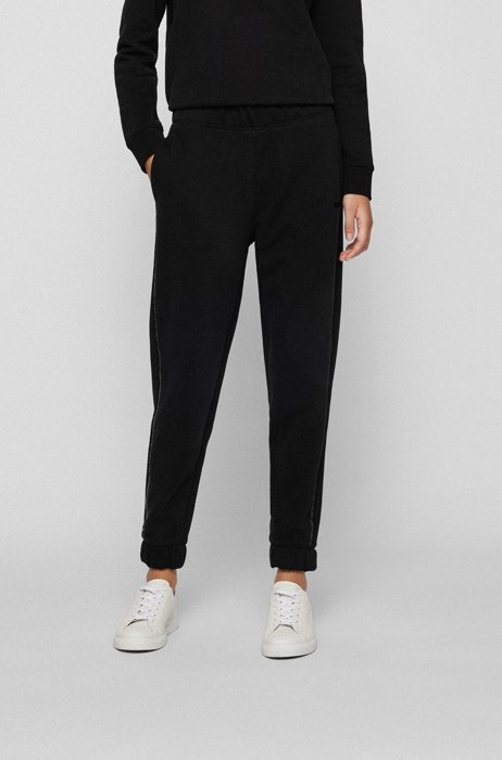 Cuffed tracksuit bottoms in cotton with sequinned seams, Black