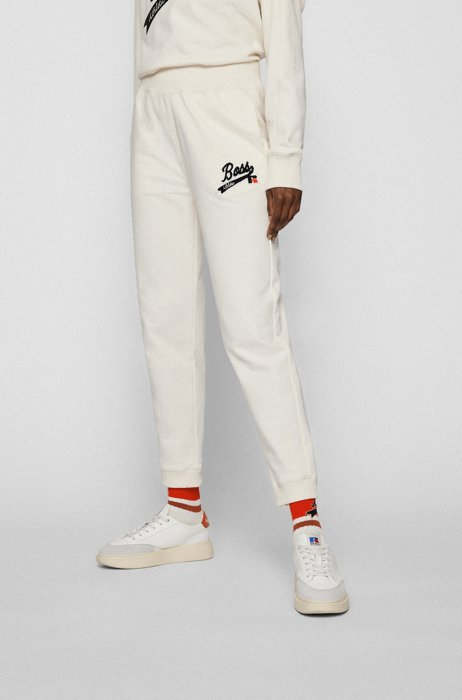 Organic-cotton-blend tracksuit bottoms with logo patch, White