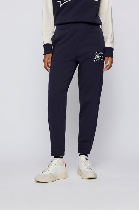 Organic-cotton-blend tracksuit bottoms with logo patch, Dark Blue
