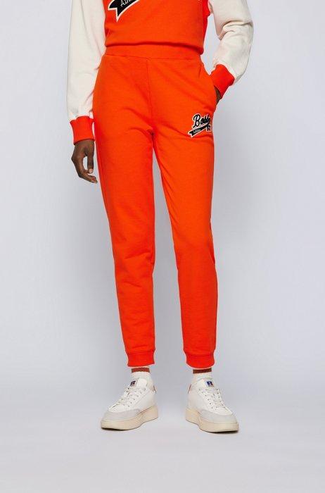 Organic-cotton-blend tracksuit bottoms with logo patch, Orange