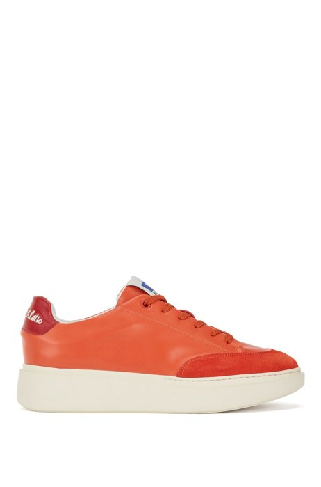 Faux-leather trainers with suede trims and collaborative branding, Orange