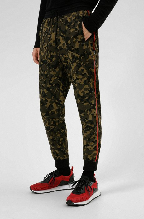Camouflage-print tracksuit bottoms in cotton jersey, Khaki