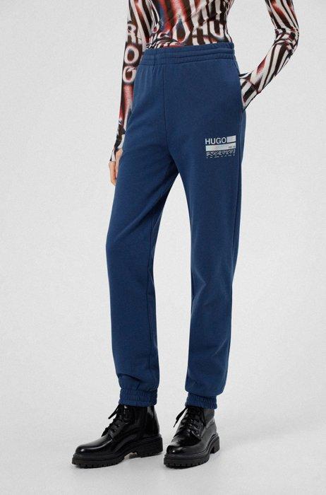 Pantalones de chándal relaxed fit con logo de manifiesto iridiscente, Azul