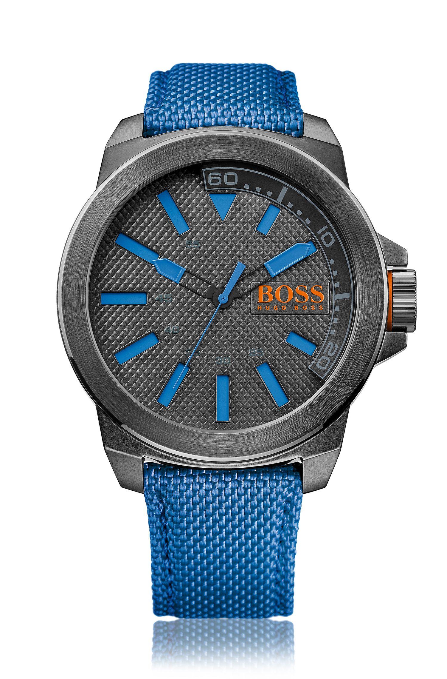 Horloge met drie wijzers en polsband van stof