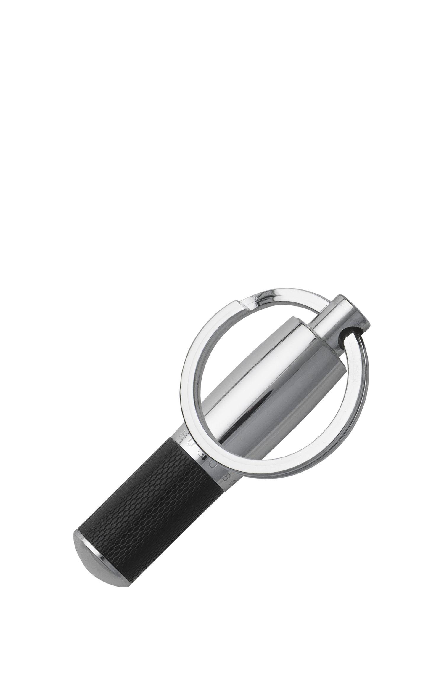 Sleutelhanger van zwarte, getextureerde lak