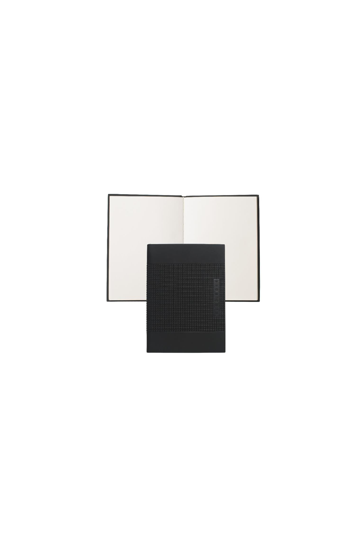 Notepad in DIN A6 format with a textured hard cover: 'Grid'