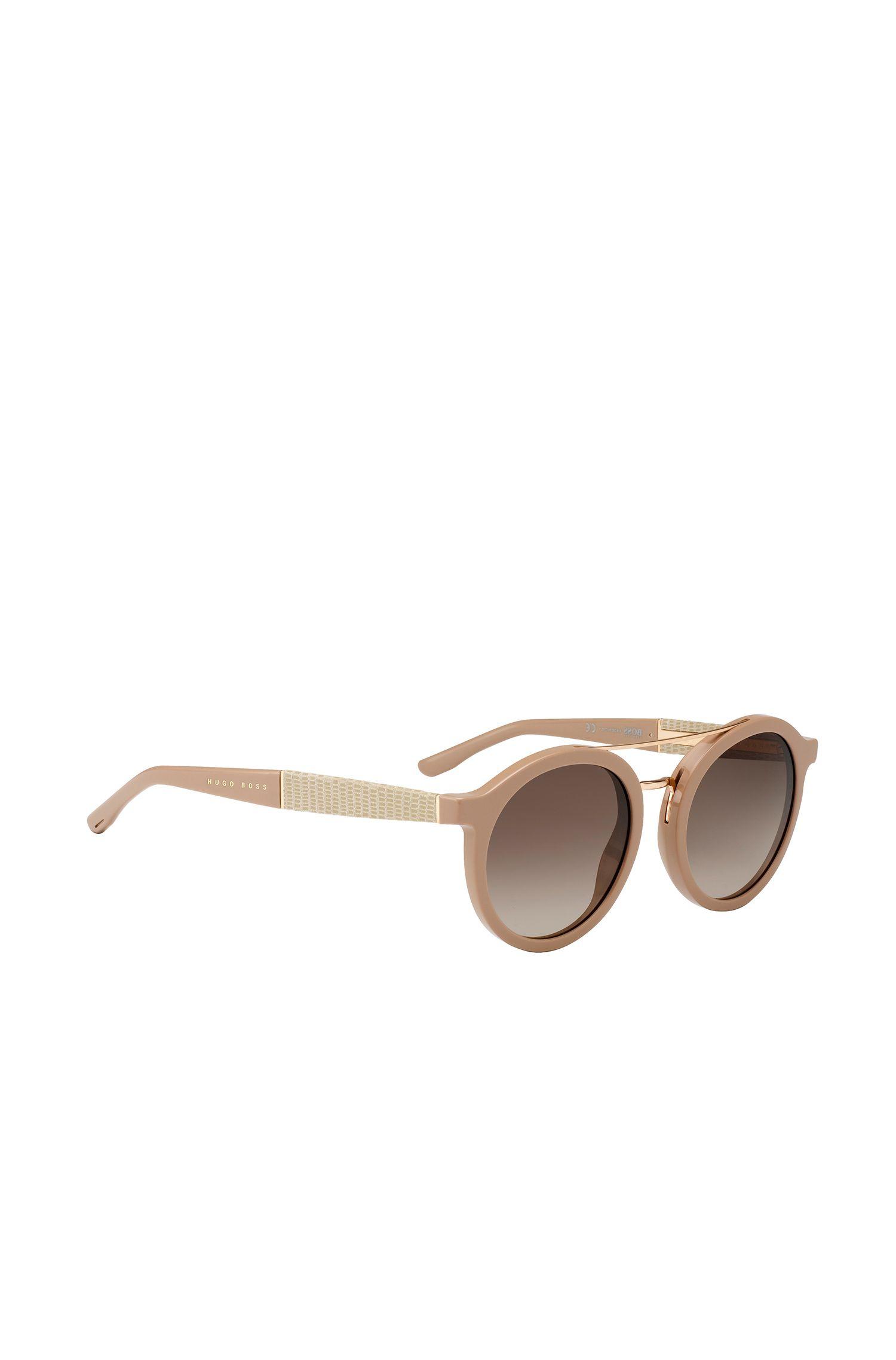 Gafas de sol redondas con patillas de piel grabada