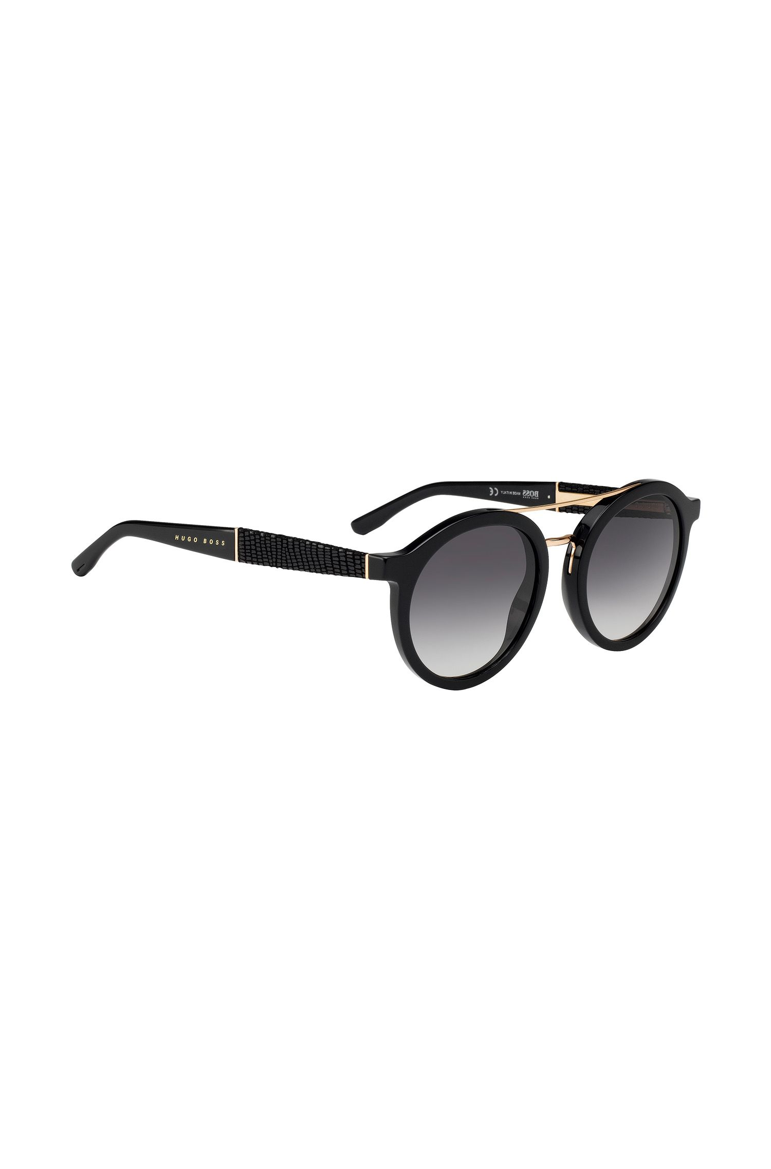 Round sunglasses with embossed leather temples