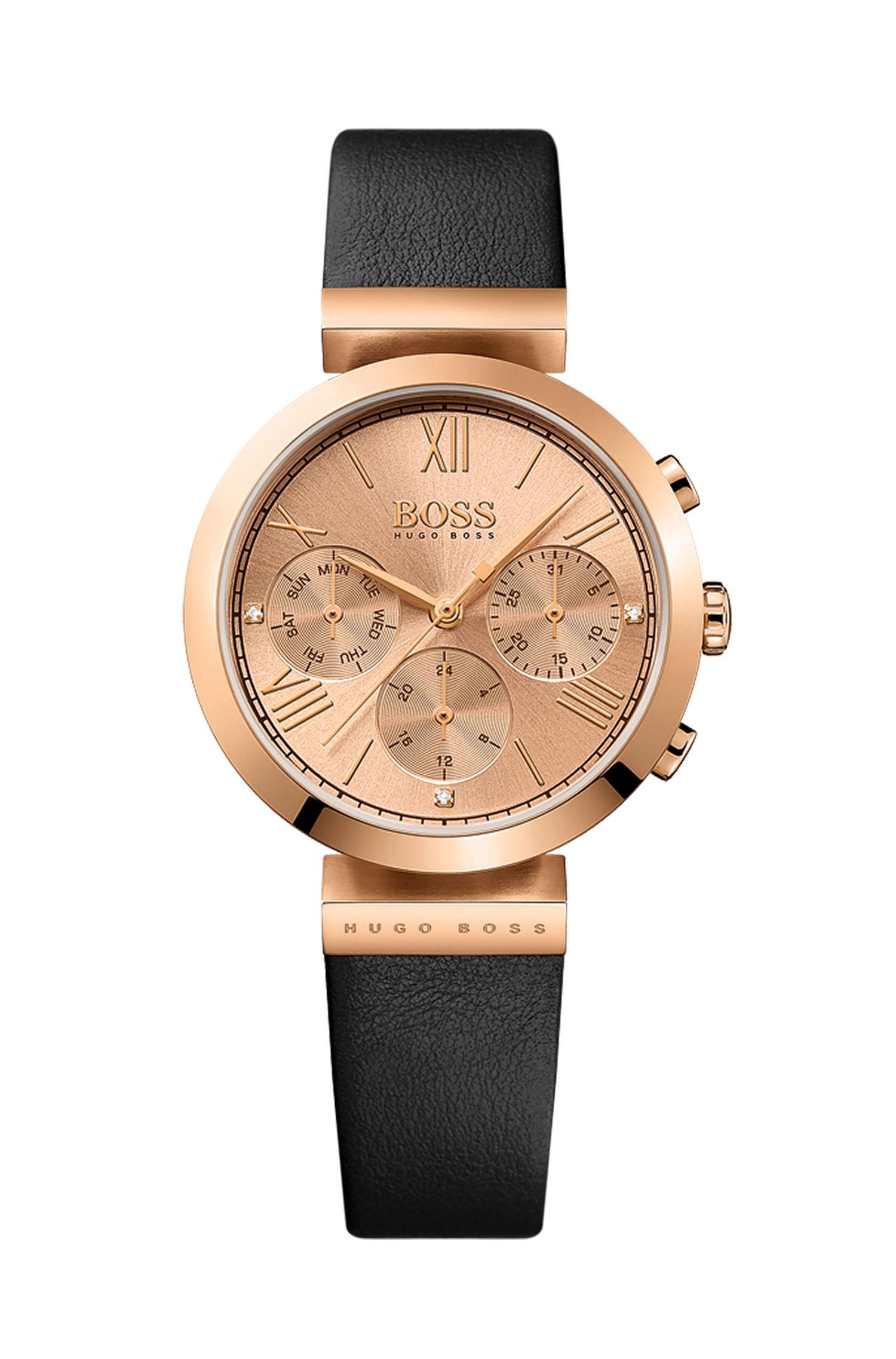 Horloge met roségoudcoating, drie wijzers en een polsband van reliëfleer