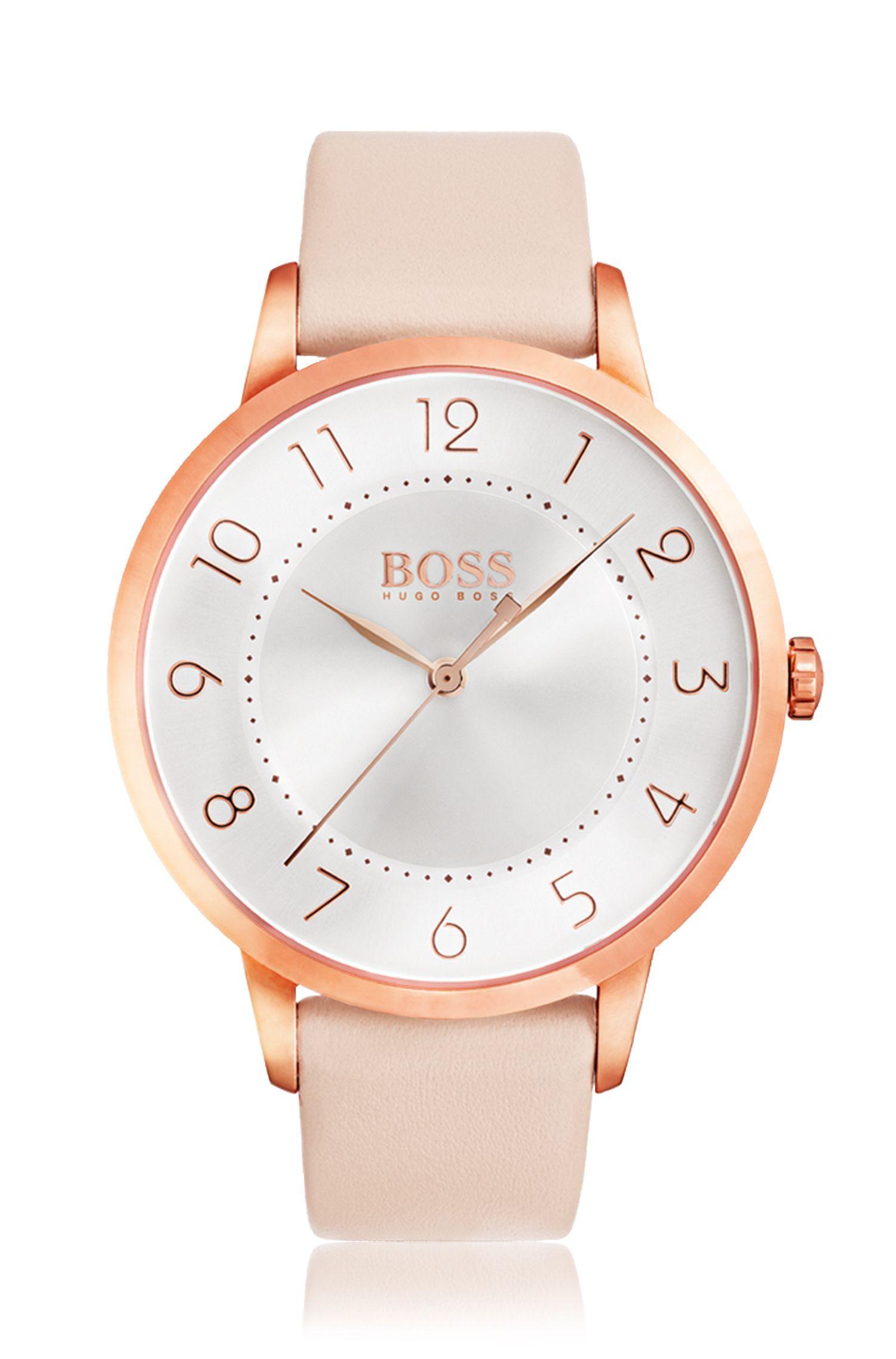 Horloge van roségoudkleurig staal met drie wijzers