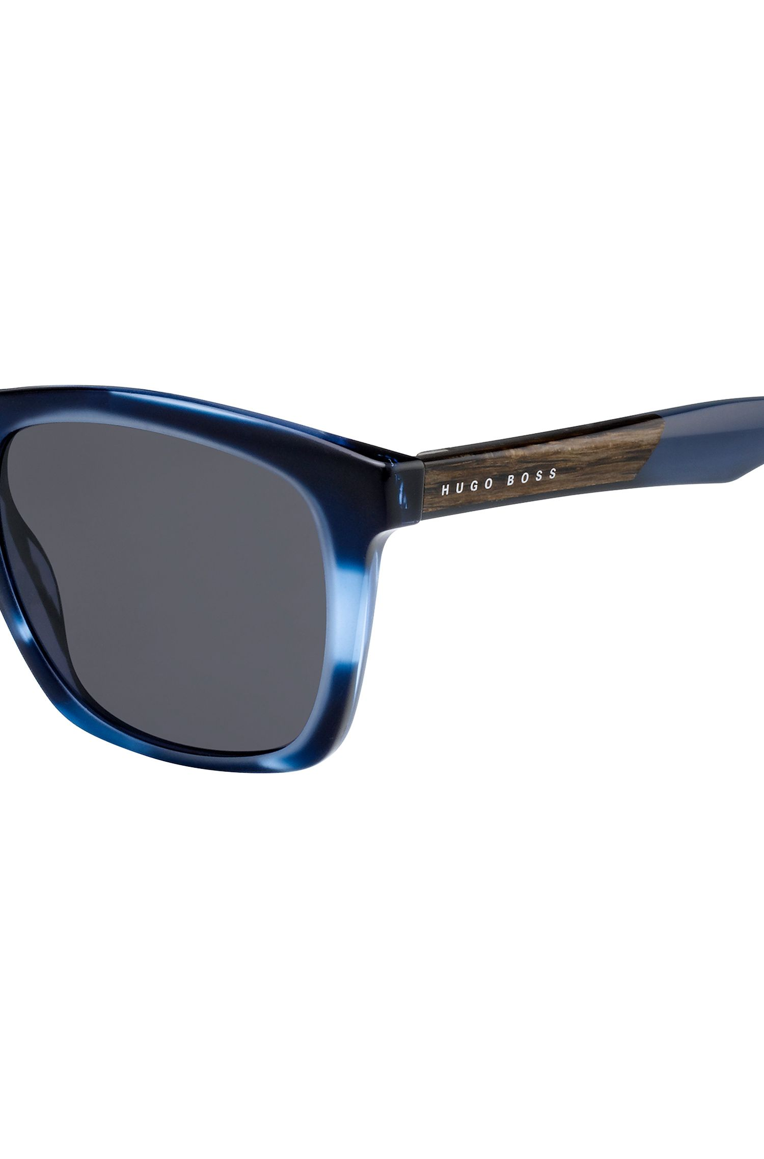 Sunglasses with coloured horn-effect frames