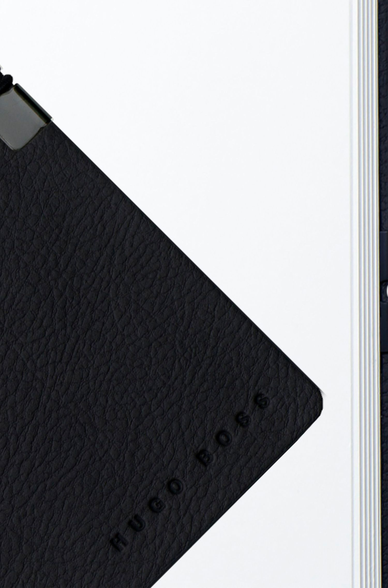 A6 notepad in dark blue faux leather