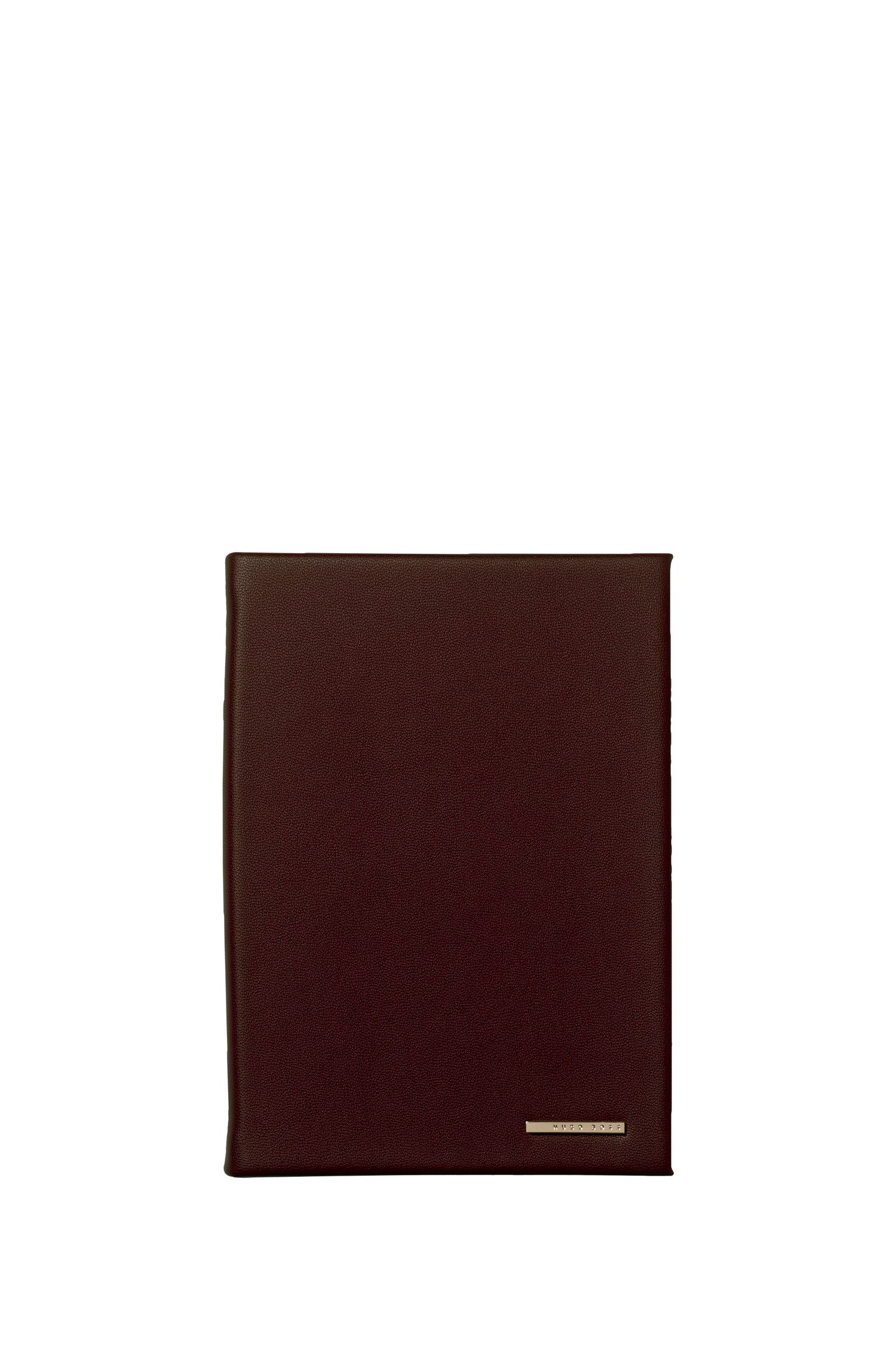 A6 faux-leather notebook in burgundy with logo plate