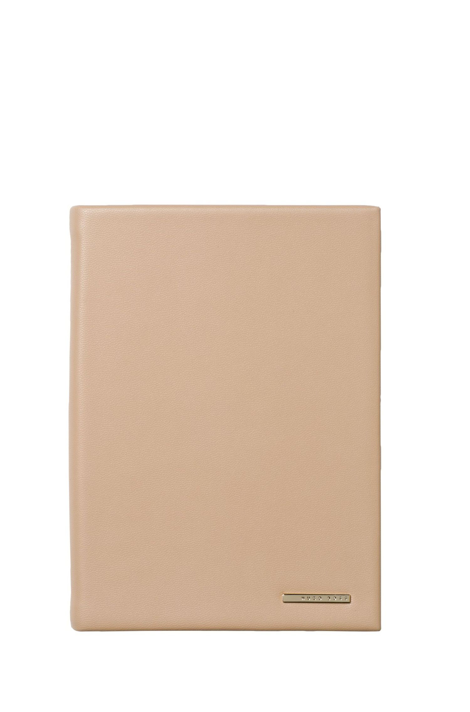 A6 notebook with nude faux-leather case and logo plate