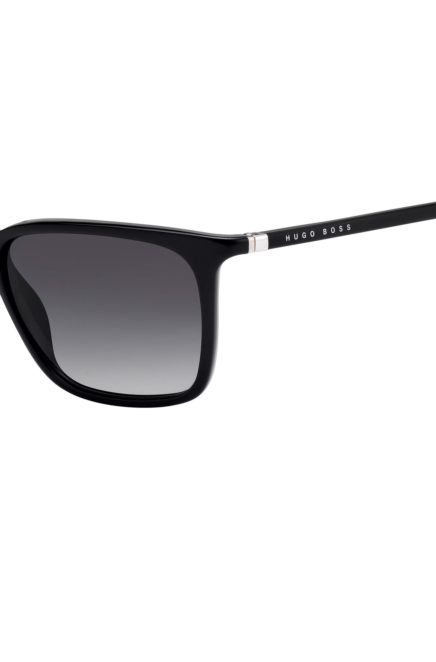 Black optyl sunglasses with integrated flexible hinges