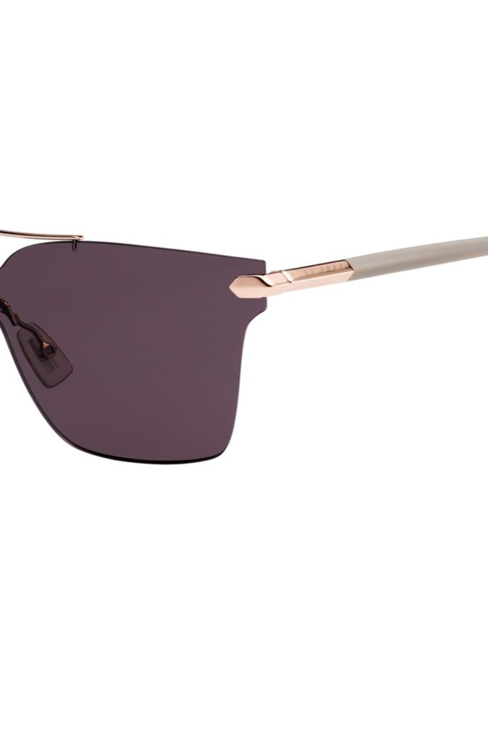 Shield sunglasses with riveted hinges