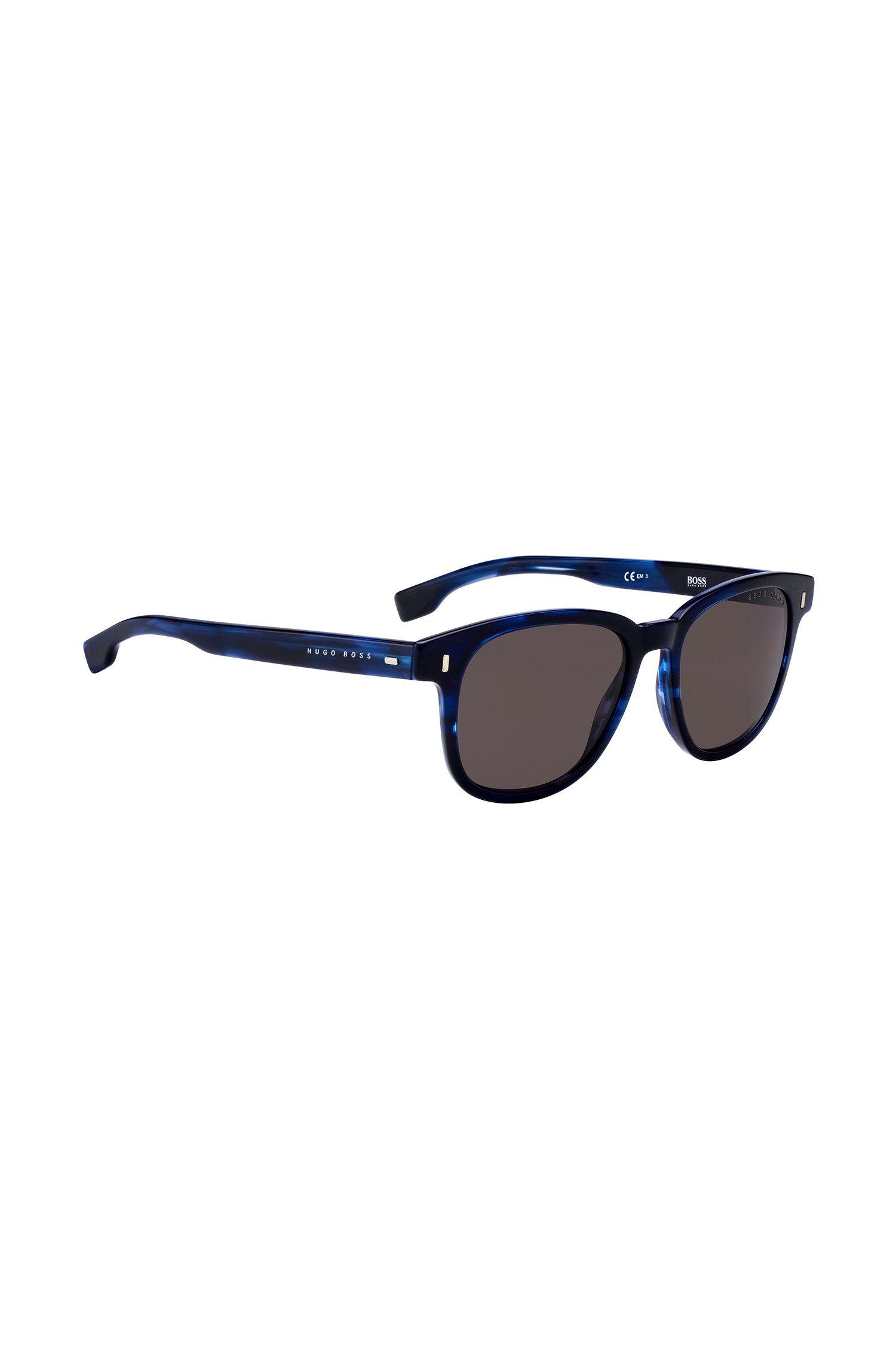 Sunglasses in blue-tinted Havana-pattern acetate