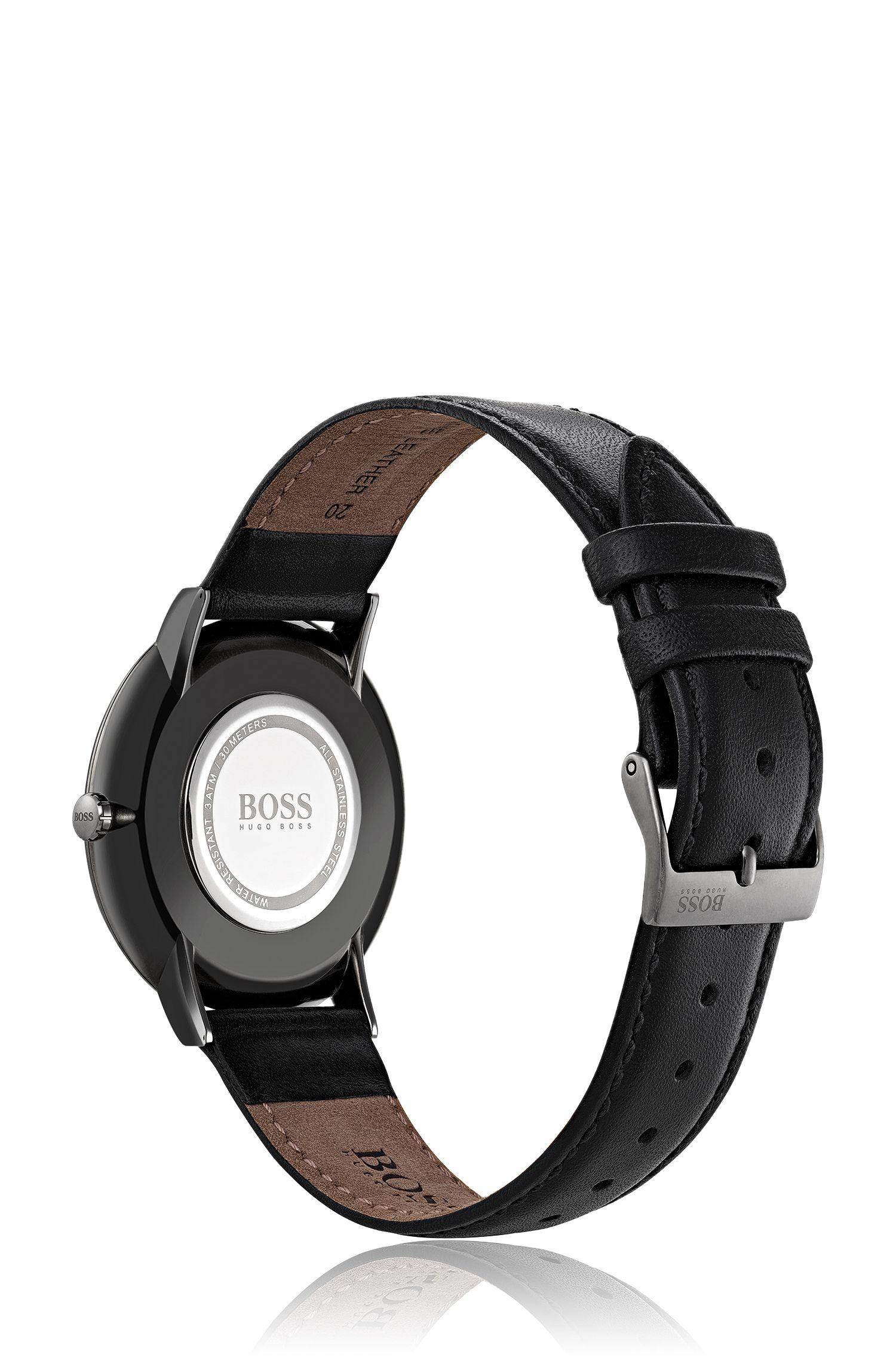 Horloge met grijze coating, minimalistische wijzerplaat en polsband van leer
