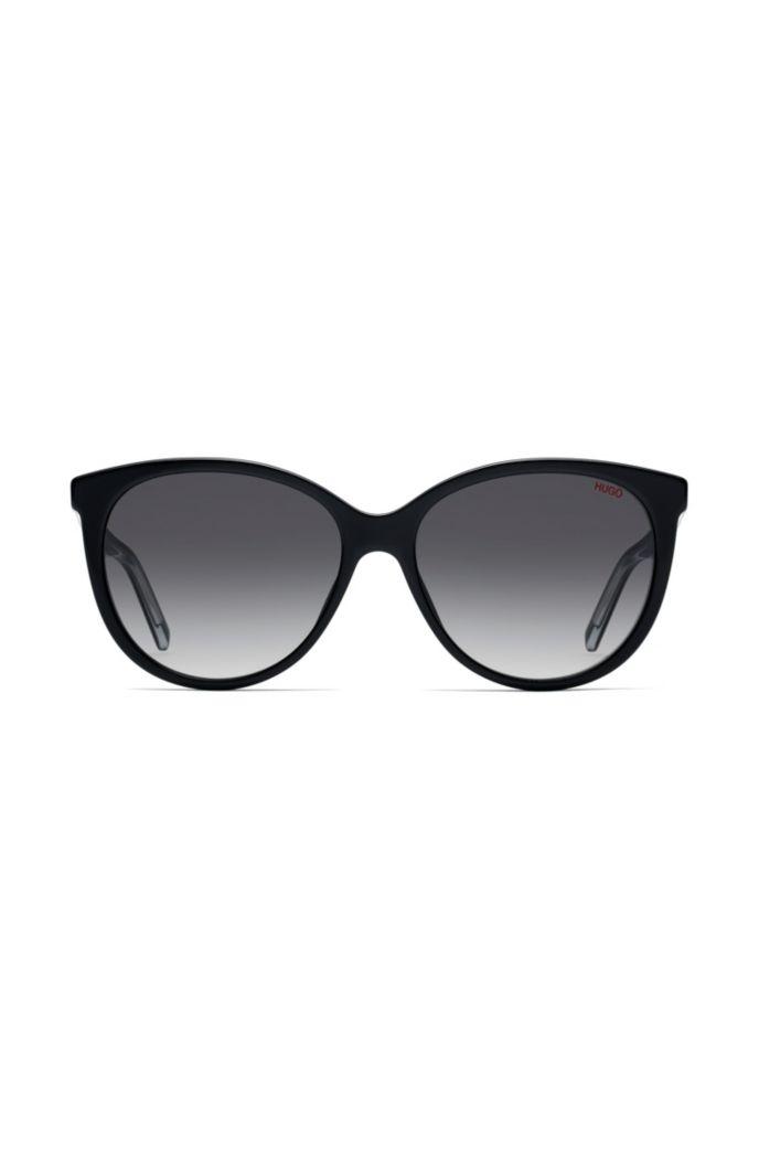 Reverse-logo sunglasses in black acetate