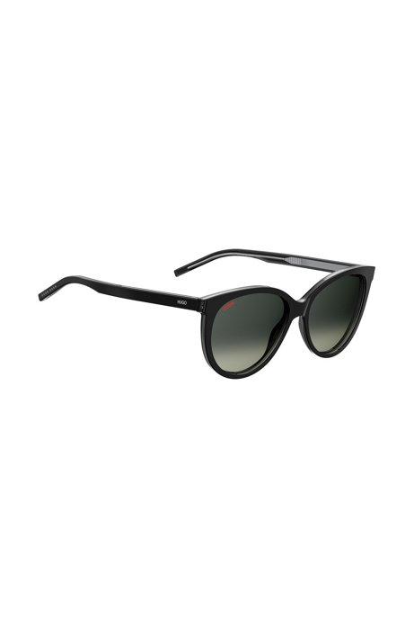 Reverse-logo sunglasses in black acetate, Black