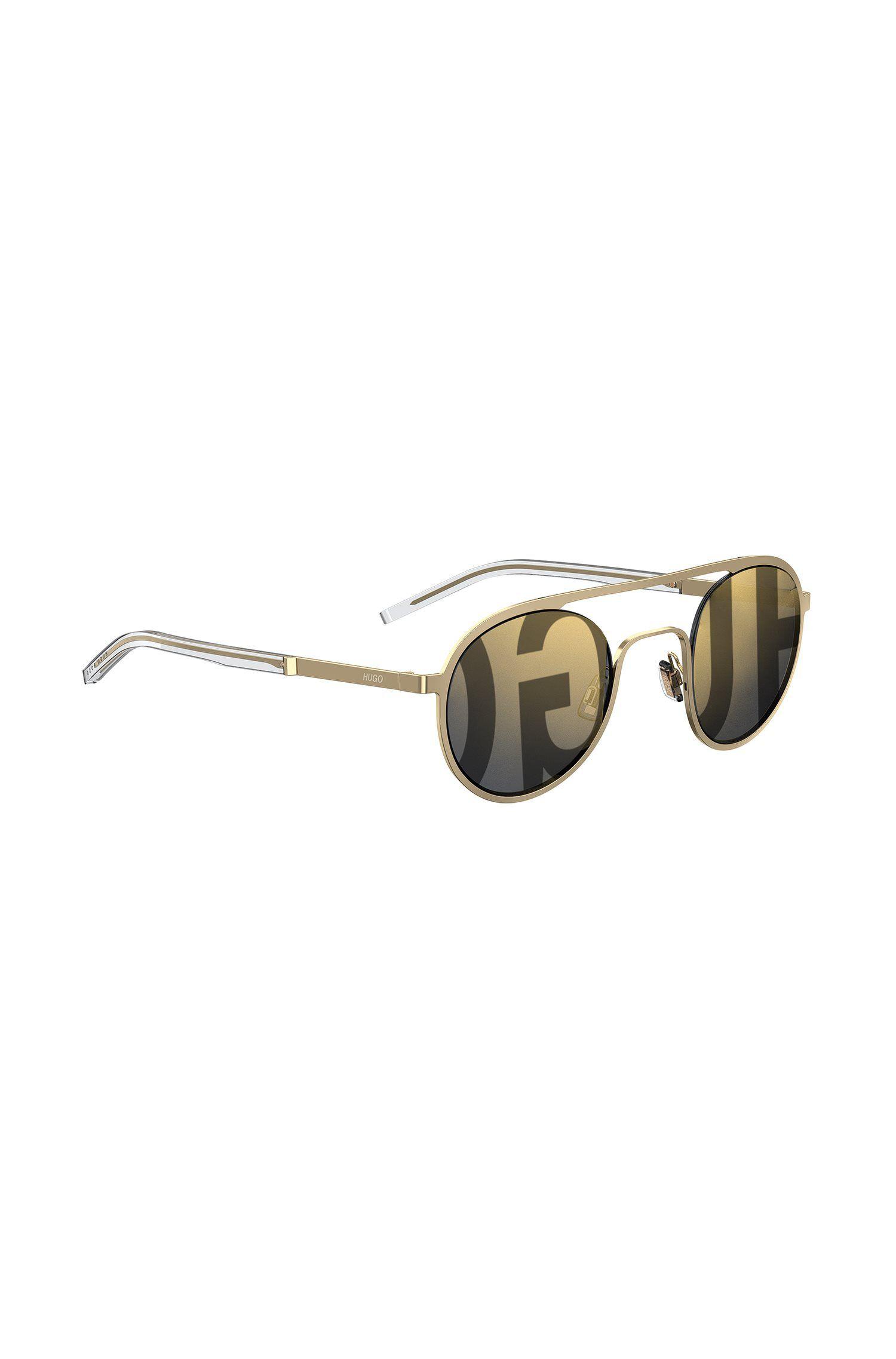 Goudkleurige, ronde uniseks zonnebril met logoglazen, goud