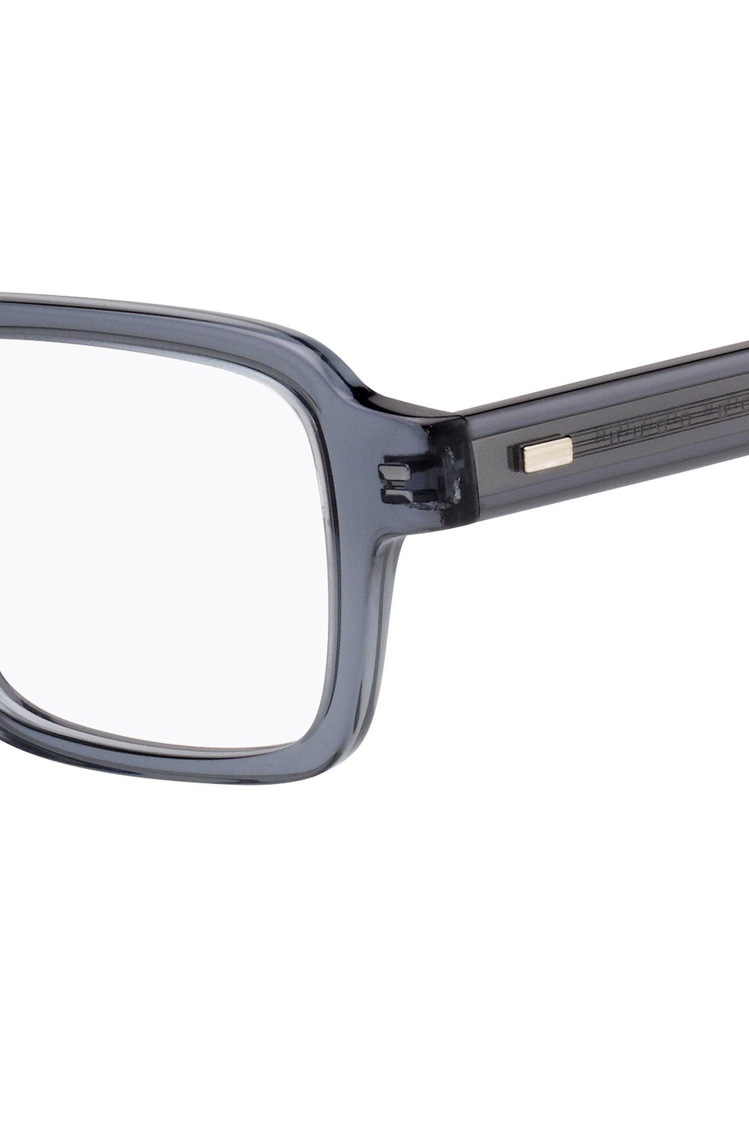 Retro-inspired glasses in transparent grey acetate, Grey