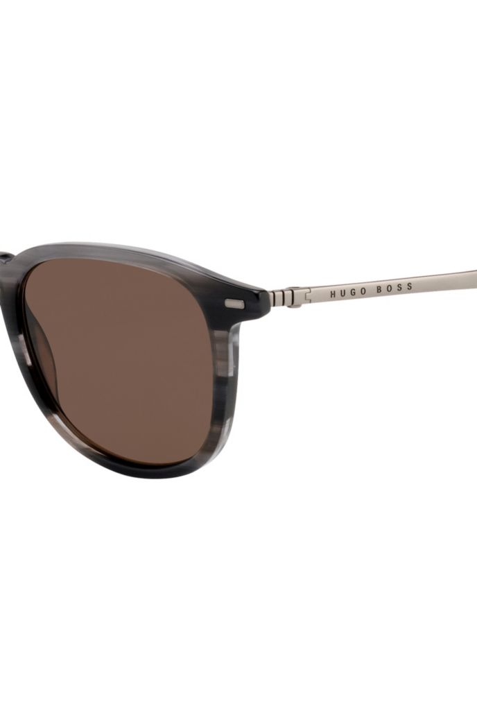 Beta-titanium sunglasses with Havana-effect frames
