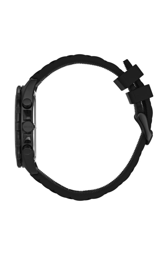 Black-plated watch with luminescent details and silicone strap
