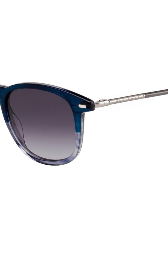 Zonnebril van blauw acetaat met hoorneffect en ronde poten van metaal