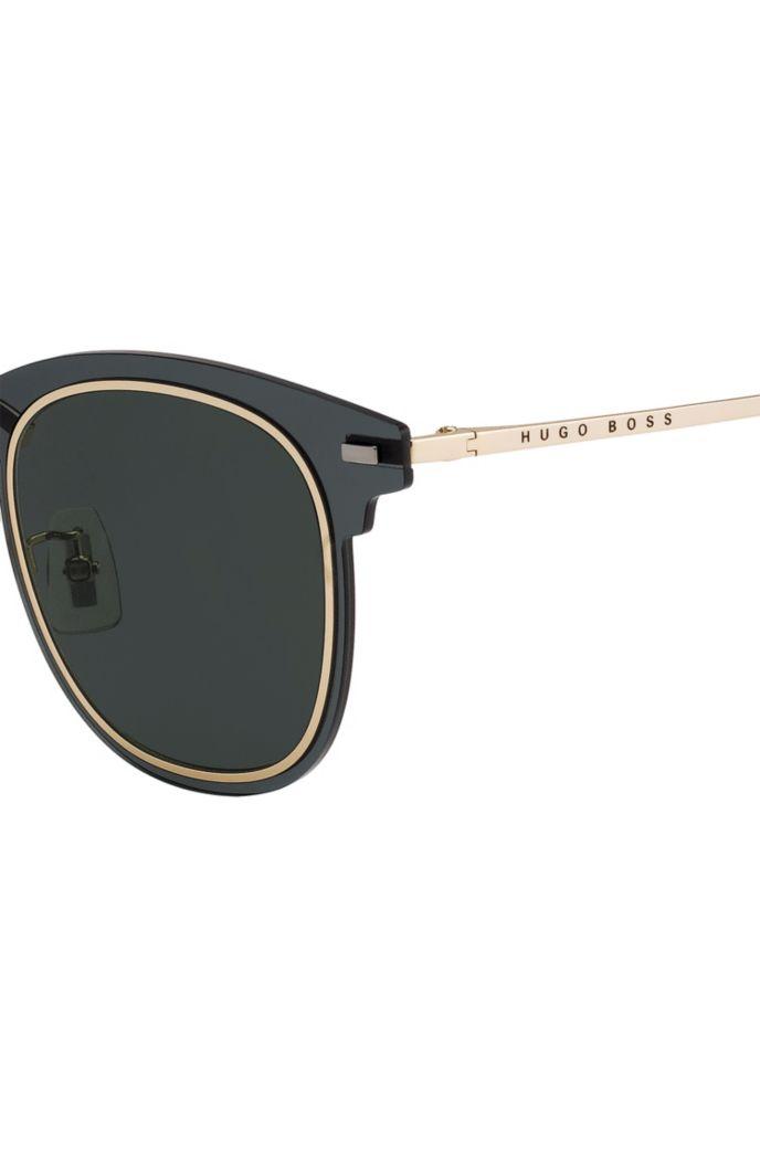 Grüne Sonnenbrille mit zwei Rillen am Rand