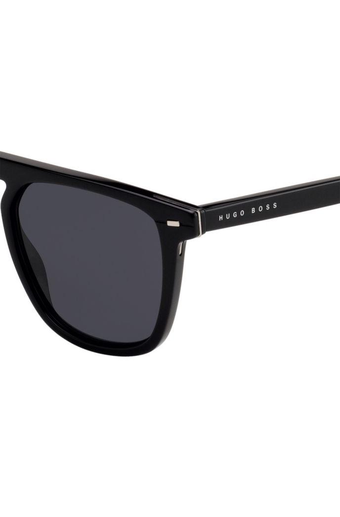 Flat-top zonnebril van zwart acetaat met hardware inzetten