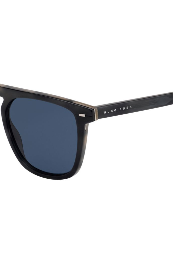 Sunglasses in grey-horn acetate with hardware inserts