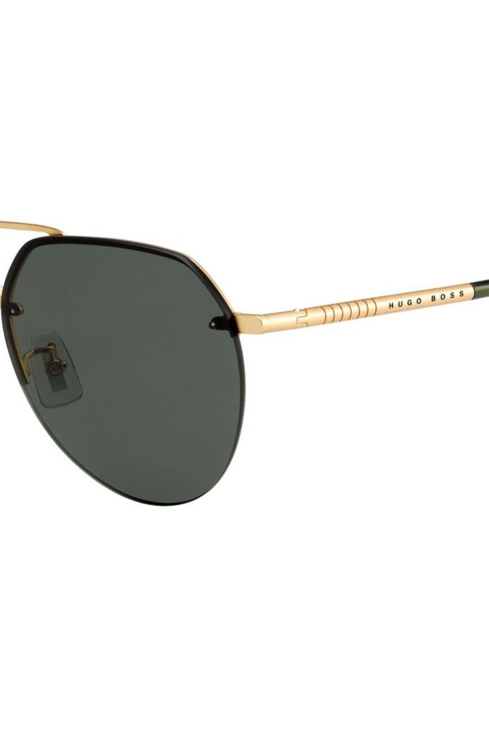 Goudkleurige zonnebril met dubbele neusbrug en ronde poten